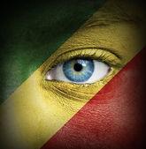 Rosto humano pintado com a bandeira da república do congo — Foto Stock