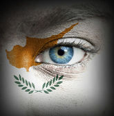 Human face painted with flag of Cyprus — Stock Photo