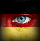 Human face painted with flag of Germany — Stock Photo