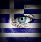 Human face painted with flag of Greece — Stock Photo