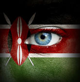 Human face painted with flag of Kenya — Stock Photo