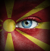 Human face painted with flag of Macedonia — Stock Photo