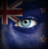 Human face painted with flag of New Zealand — Stock Photo