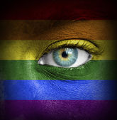 Human face painted with flag of Pride (Gay) — Stock Photo