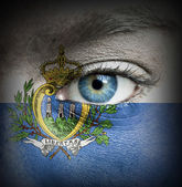 Human face painted with flag of San Marino — Stock Photo