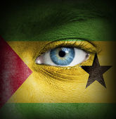 Human face painted with flag of Sao Tome and Principe — Stock Photo