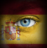 Human face painted with flag of Spain — Stock Photo
