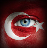 Human face painted with flag of Turkey — Stock Photo
