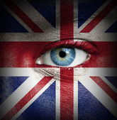 Human face painted with flag of United Kingdom — Stock Photo
