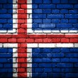 Brick wall with painted flag of Iceland — Stok fotoğraf