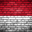 Brick wall with painted flag of Indonesia — Stock Photo #41759665