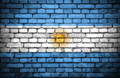 Brick wall with painted flag of Argentina — Stock Photo