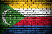 Brick wall with painted flag of Comoros — Стоковое фото