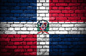 Brick wall with painted flag of Dominican Republic — Stock Photo