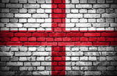 Brick wall with painted flag of England — Stock Photo