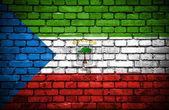 Brick wall with painted flag of Equatorial Guinea — Stock Photo