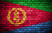 Brick wall with painted flag of Eritrea — Stock Photo