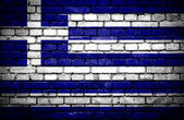 Brick wall with painted flag of Greece — Stock Photo