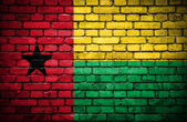 Brick wall with painted flag of Guinea Bissau — Stock Photo