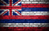 Brick wall with painted flag of Hawaii — Stock Photo