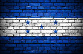 Brick wall with painted flag of Honduras — Stock Photo