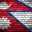 Brick wall with painted flag of Nepal — Stock Photo
