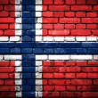 Brick wall with painted flag of Norway — Stok fotoğraf
