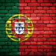 Brick wall with painted flag of Portugal — Stok fotoğraf