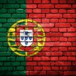 Brick wall with painted flag of Portugal — Stockfoto