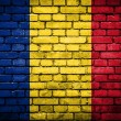 Brick wall with painted flag of Romania — Stok fotoğraf