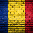 Brick wall with painted flag of Romania — Stockfoto