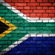 Brick wall with painted flag of South Africa — Stock Photo #41764921
