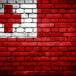 Brick wall with painted flag of Tonga — Стоковое фото