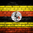 Brick wall with painted flag of Uganda — Stock fotografie
