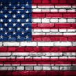 Brick wall with painted flag of United States of America — Stock Photo