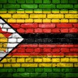 Brick wall with painted flag of Zimbabwe — Stock fotografie