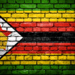 Brick wall with painted flag of Zimbabwe — Stockfoto
