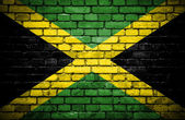 Brick wall with painted flag of Jamaica — Stock Photo