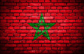 Brick wall with painted flag of Morocco — Stock Photo