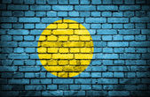 Brick wall with painted flag of Palau — Stock Photo