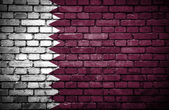 Brick wall with painted flag of Qatar — Stock Photo