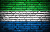 Brick wall with painted flag of Sierra Leone — Stock Photo
