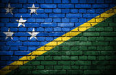 Brick wall with painted flag of Solomon Islands — Stock Photo