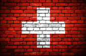 Brick wall with painted flag of Switzerland — Stock Photo