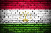 砖墙与彩绘国旗的塔吉克斯坦 — 图库照片