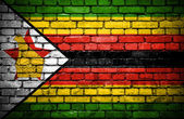 Brick wall with painted flag of Zimbabwe — Stock Photo