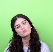 Portrait of girl with funny face against green background — Stock Photo