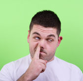 Portrait of a young man with his finger in his nose — Foto Stock