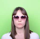 Portrait of woman with retro glasses against green background — Stock Photo