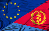 Waving flag of Eritrea and EU — Stock Photo